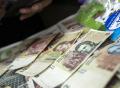 argentina-billetes-economia-acciones